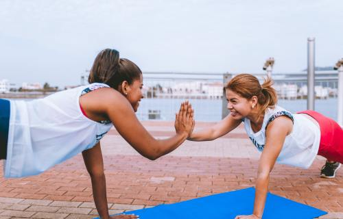 Women exercising and high-fiving