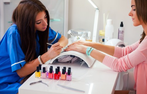 Woman working in nail salon giving manicure