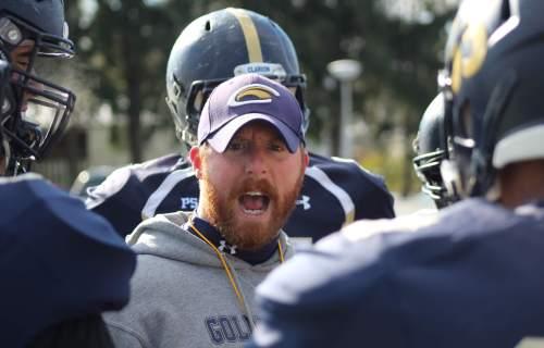 Football coach talking to team