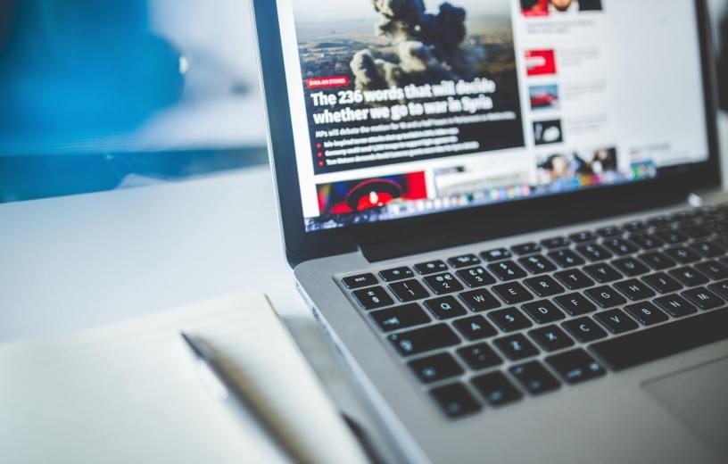 News website on laptop