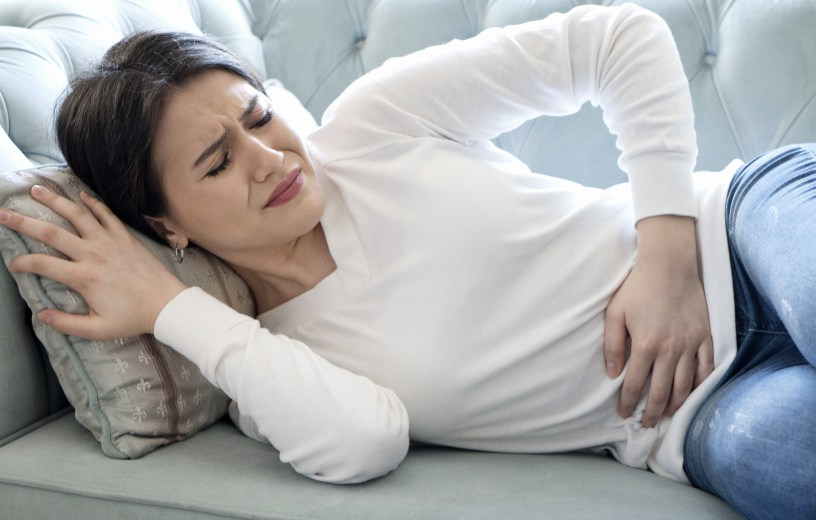 Woman experiencing stomach pain, bloating