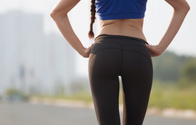Fit woman working out wearing yoga pants
