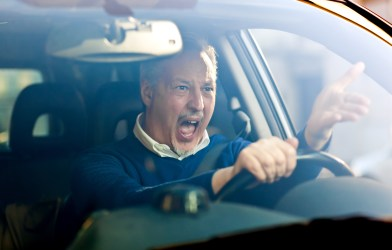 Angry, stressed driver having bad commute, road rage
