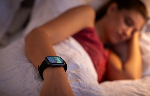 Woman sleeping with sleep tracker