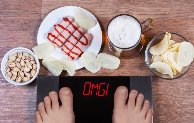 """Weight gain: Scale says """"OMG"""" with snacks around it"""
