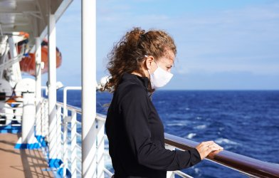 Woman wearing mask on cruise ship during coronavirus outbreak