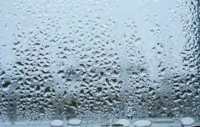 Water vapor or rain drops on window
