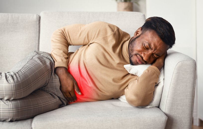 Man battling stomach pain from possible gastrointestinal disorder
