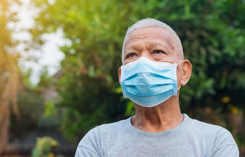 Older man wearing face mask during COVID-19 / coronavirus pandemic