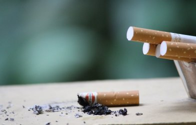 Cigarettes, with one cigarette put out