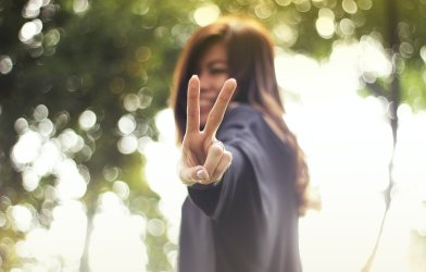 Woman showing 'peace' sign