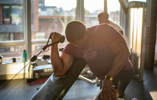 Man working out at gym, lifting weights