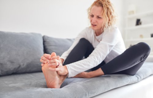 Woman with pain in her feet, joints