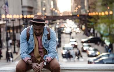 Man sitting alone, feeling sad, depressed