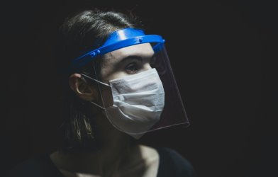 Woman wearing face shield and face mask during coronavirus pandemic