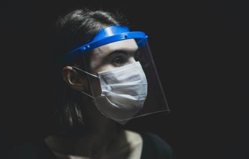 Woman wearing face shield and face mask during coronavirus pandemic