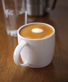 "THE AMERICAN OFFERING: ""Expertly steamed whole milk poured over two shots of espresso, topped with microfoam swirled into beautiful latte art,"" that's how Starbucks is selling our flat white."