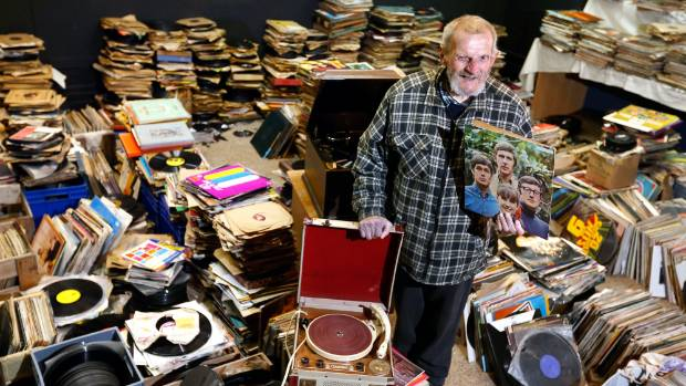 Ian Murray with his collection of records, numbering well into the thousands.