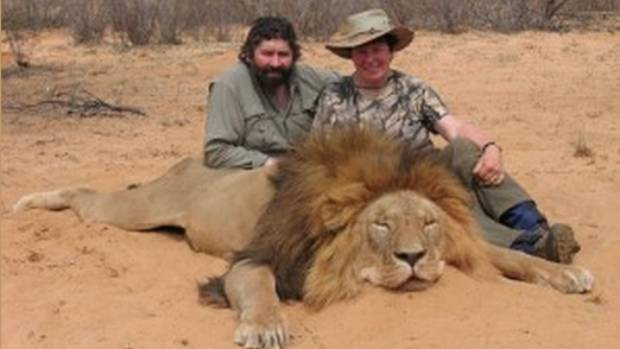 Stu and Judy Rees, of Gore, with a freshly slain lion.