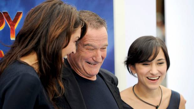 "Robin Williams , wife Susan Schneider and their daughter Zelda Williams at the premiere of ""Happy Feet Two"" in, November 2011."