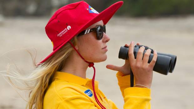 Naomi Darvill, a lifeguard at Taylors Mistake Beach, looks over the water.
