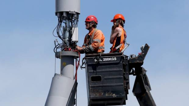 Workers repair a cell tower on Linwood Ave.