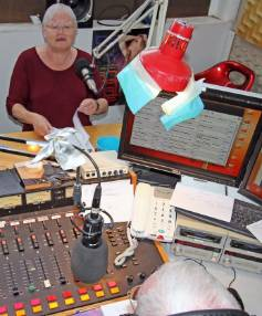 Hutt Radio volunteer Ginny Brewer reads the news at the station in Naenae.