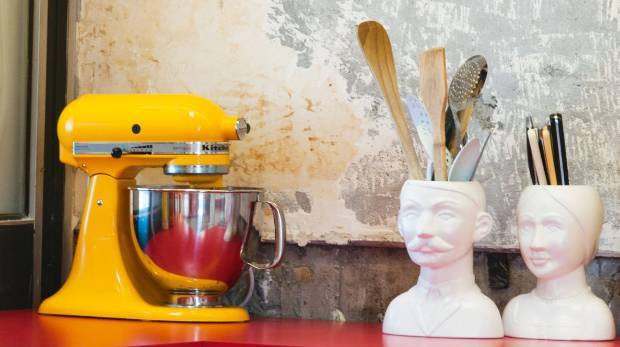 Bright kitchen appliances and interesting ornaments draw the eye away from exposed walls or ugly cabinetry.