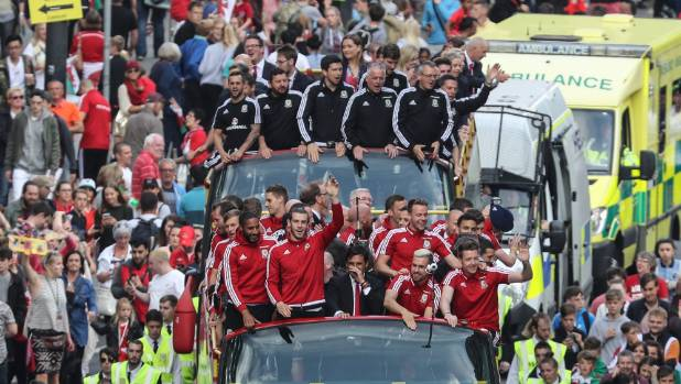 Wales' football team go on parade through central Cardiff on their return from Euro 2016.