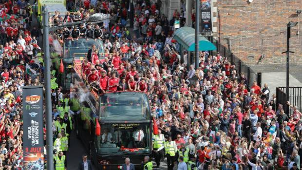 The Welsh team was carried on two open top buses.