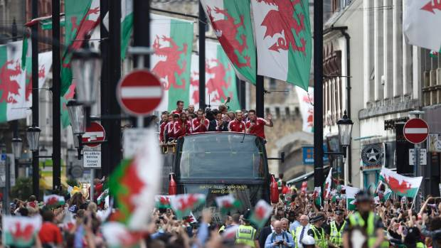 Welsh flags flew proudly in the streets of Cardiff as the footballers went on parade.