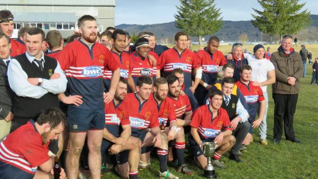 Cromwell players pose with the trophy following its win over Maniototo in the Central Otago premier rugby final at Alexandra.