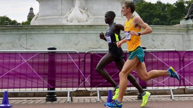 Guor Marial, competing as an independent athlete, and Australian Martin Dent in action during the London 2012 men's marathon.