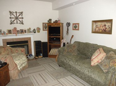 The reorganized living room with the new carpet.