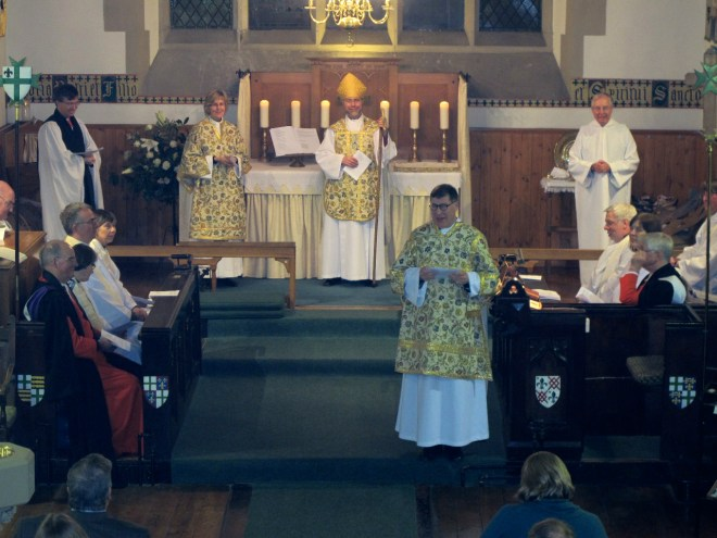 With the Bishop and Dean of the Diocese of Edinburgh at the altar, Canon Allan Maclean addresses his new congregation during his Institution on St Vincent's Day, 22 January 2015