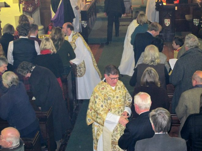 The Bishop of Edinburgh and Canon Allan Maclean greeting the congregation during the Institution Eucharist on St Vincent's Day, 22 January 2015