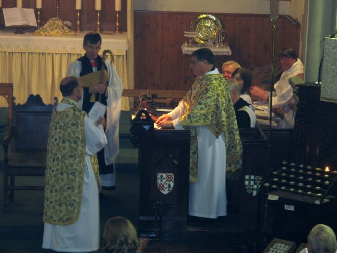 The Bishop of Edinburgh with his Chaplain at his side addresses Canon Allan Maclean during his Institution as Rector of St Vincent's on St Vincent's Day, 22 January 2015