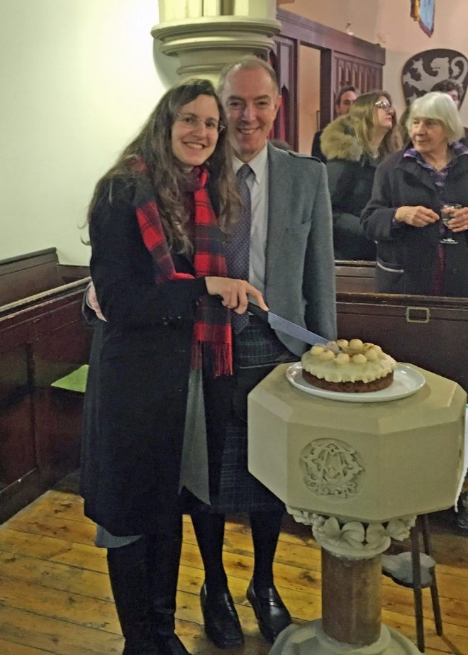 Mike and Eleonora Hull cut the Easter Simnel cake at St Vincent's on Easter Day 2106