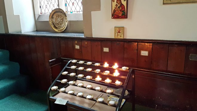 The pricket stand with its candles within St Vincent's