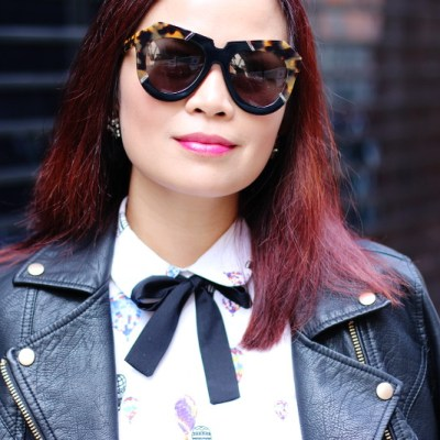 leather-jacket-bow-tie-neck-karen-walker-sunglass-pink-lipstick