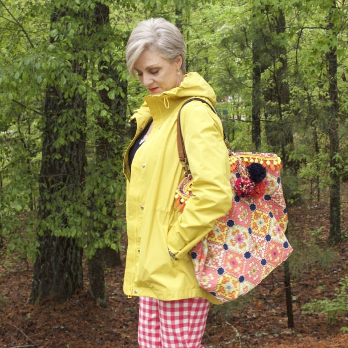 marks and spencer yellow slicker, boden gingham pants, boden cashmere sweater, sperry sneakers, trina turk tote, over 50 fashion blogger