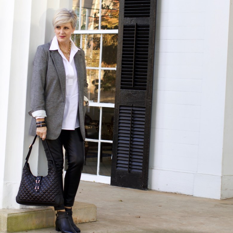 beth at Style at a Certain Age wears faux leather leggings, white shirt, boyfriend blazer, and black booties
