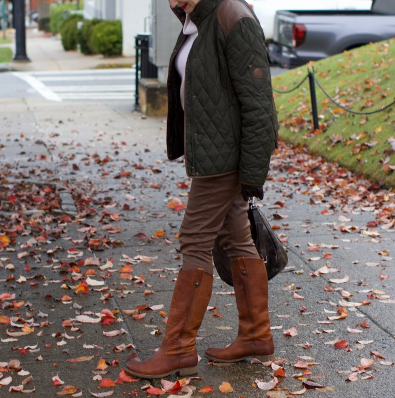 beth from Style at a Certain Age is wearing Ralph Lauren faux leather pants, chunky cashmere sweater, green utility jacket, Frye boots, and Frye hobo handbag