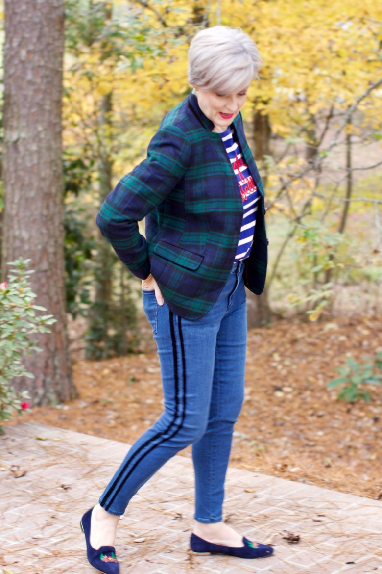 beth from Style at a Certain age wears velveteen black watch plaid pants, blue ribbed turtleneck, and loafers