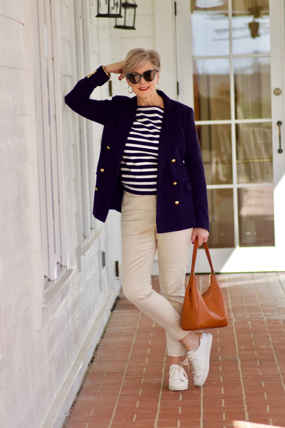 beth from Style at a Certain Age wears J.Crew striped tee, chinos, Ralph Lauren navy blue knit blazer, and white sneakers