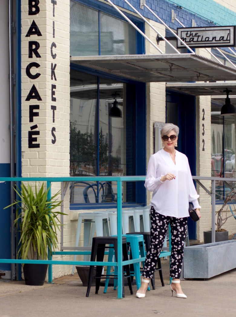 beth from Style at a Certain Age wears an outfit from Lord & Taylor, black pattern pants, white tunic blouse, Sam Edelman shoes
