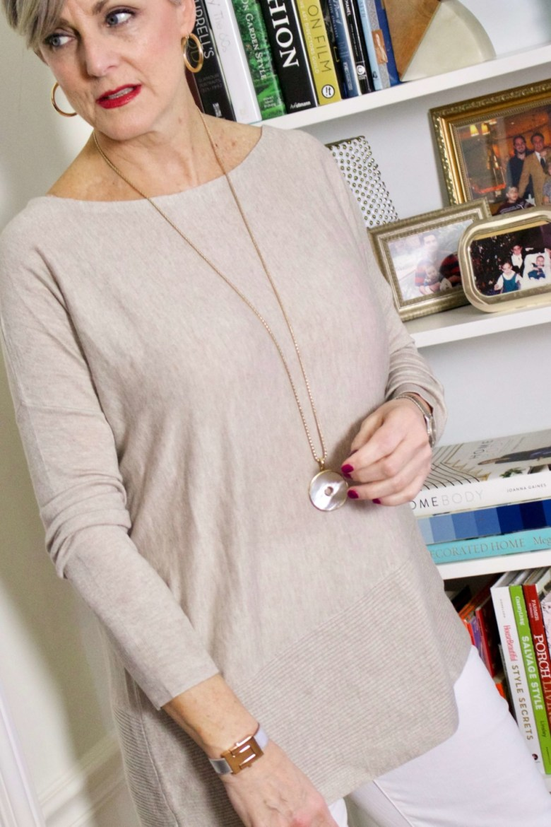 beth from Style at a Certain Age wears spring neutrals, white denim, asymmetrical tunic, snakeskin sandals