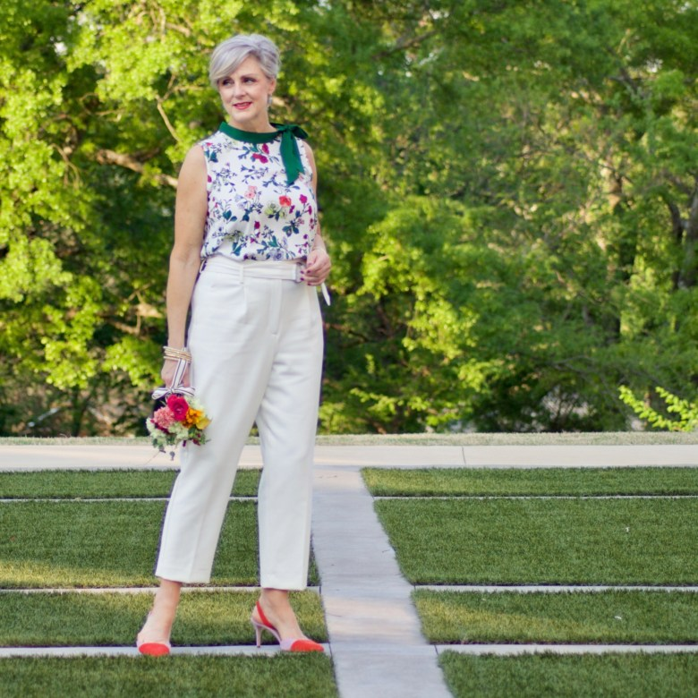 beth from Style at a Certain Age wears Ann Taylor floral tie neck blouse, pleated pants and suede slingbacks