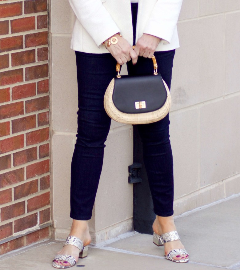 beth from Style at a Certain Age wears a textured ivory blazer, ivory scalloped shell, dark rinse skinny jeans, snakeskin sandals and wicker handbag