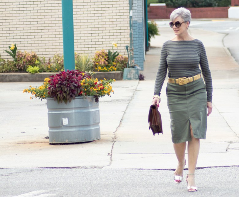 green pencil skirt, green striped tee, gold accessories
